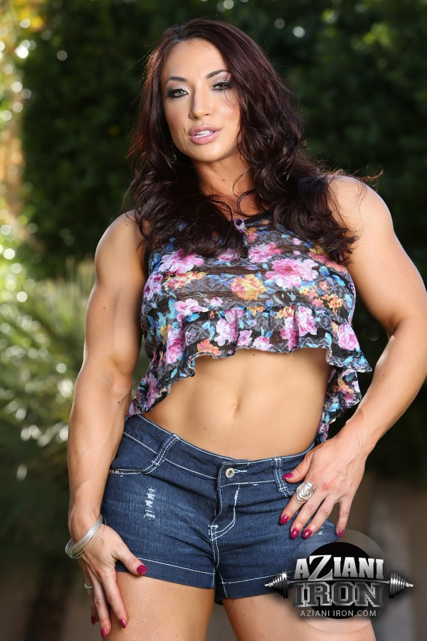 Brandi Mae flexing her muscles and stripping