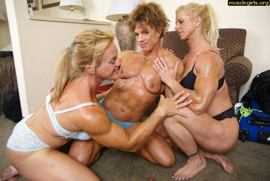 Three lesbian bodybuilders having fun