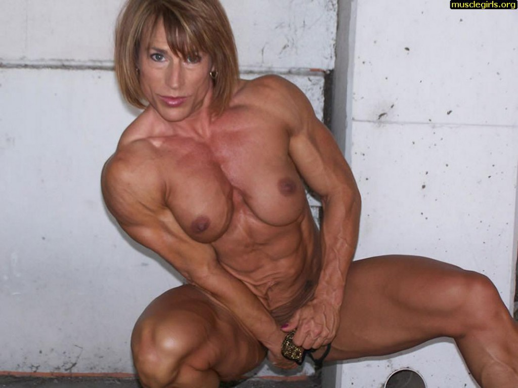 Bodybuilder female athlete sex machine