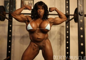 Ebony female bodybuilder Yvette Bova flexhing her arms