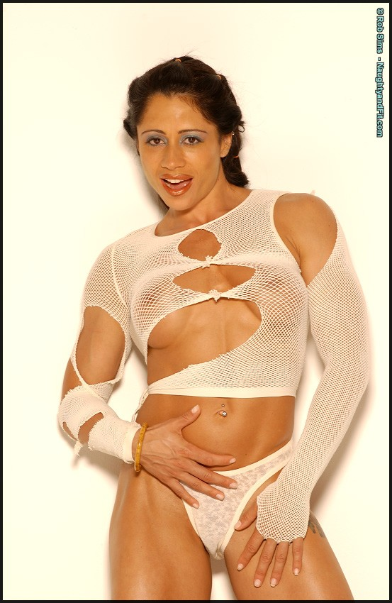 Tara Scotti posing in ripped fishnet top and panties