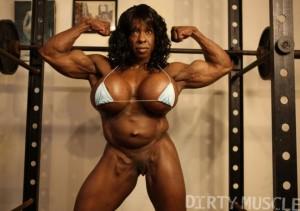Ebony female bodybuilder Yvette Bova flexhing her arms